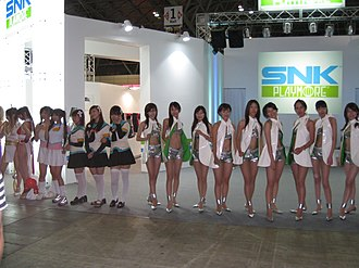 SNK - SNK Playmore exposition at the TGS 2007, including two promotional models dressed up as the company mascot Mai Shiranui (far left)
