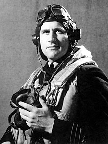 Half portrait of man in dark military uniform with life vest, flying cap, goggles and oxygen mask