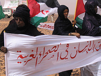 Moroccan Western Sahara Wall - Sahrawi women hold a protest in Western Sahara on the eastern side of the wall.