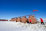 Secretary Kerry Walks Past a Series of Fuel Tanks After he Landed at Marble Point, Antarctica (30913580195).jpg