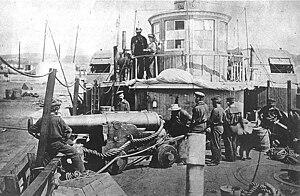 Sighting a gun aboard Thomas Freeborn, 1861