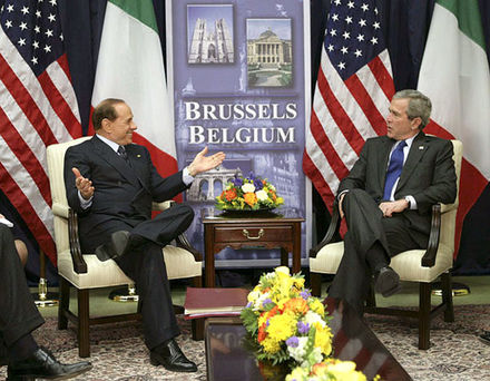 Berlusconi smiles with U.S. President George W. Bush at the NATO headquarters in Brussels. Silvio Berlusconi and George W. Bush at NATO Headquarters in Brussels.jpg