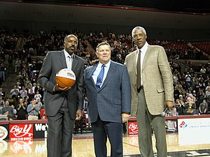 Al Skinner - Left to right: Al Skinner, Jack Leaman, and Julius Erving at the ceremony to retire Skinner's UMass jersey.