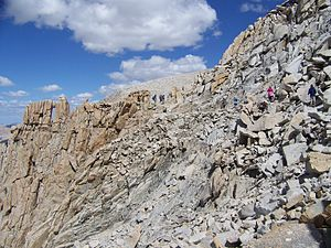 John Muir Trail - Hikers approach the southern end of the John Muir Trail. The Mount Whitney summit plateau can be seen in the distance.
