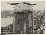 Southern pylon of the Harbour Bridge being washed, 1932 (8283764770).jpg