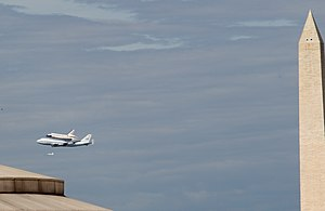 Space Shuttle Discovery next to Mounument.jpg