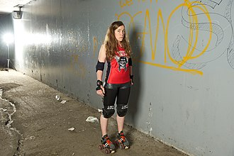 "Spenard, Anchorage - Rage City Rollergirls jammer ""Spenard Itch"" poses underneath the bridge which carries Spenard Road over Fish Creek."