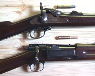 Springfield Model 1892–99 - Receiver, loading door and bolt assembly of a US M1898 Krag–Jørgensen Rifle with a .30-40 round as compared to a .45-70 Springfield Model 1888 rifle, its predecessor.