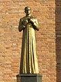 Statue of Jerzy Popiełuszko in Sieradz (2008).jpg