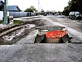 Storm drain pushed up through road in the 2010 Canterbury earthquake.jpg