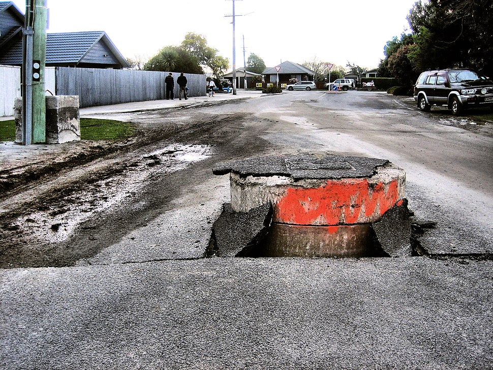 Storm drain pushed up through road in the 2010 Canterbury earthquake