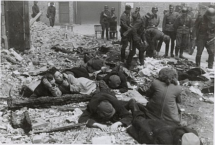 Polish Jews pulled from a bunker by German troops; Warsaw Ghetto Uprising, 1943 Stroop Report - Warsaw Ghetto Uprising 11.jpg
