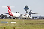 Sunstate Airlines (VH-QON) Bombardier DHC-8-402Q taking off on runway 25 at Sydney Airport.jpg