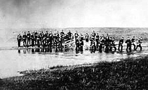 Swift Current - Halifax Provisional Battalion fording a stream near Swift Current, District of Assiniboia, 1885
