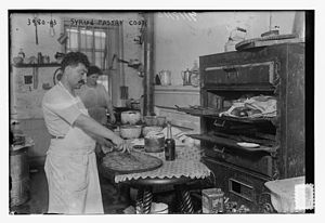 Syrian diaspora - Syrian baklava maker in Little Syria in 1916.