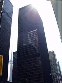 TD Centre towers frame CN Tower in Toronto.