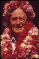 THIS TOURISTS HAS ACQUITTED HERSELF WELL AT A HULA DANCE DEMONSTRATION. THE LEIS ARE HER REWARDS - NARA - 553760.tif