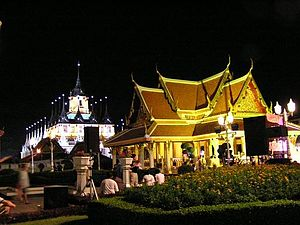 Phra Nakhon District - Thai architecture brightly lit in yellow at Lan Plabpla Maha Chedsada Bodin, 222nd anniversary of Bangkok