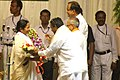 The Chief Minister of West Bengal, Ms. Mamata Banerjee being greeted by the Union Home Minister, Shri P. Chidambaram, the Union Finance Minister, Shri Pranab Mukherjee and the Minister of State for Railways.jpg