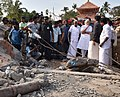 The Prime Minister, Shri Narendra Modi and the Chief Minister of Kerala, Shri Oommen Chandy, takes stock of the situation at Puttingal temple, Paravur, in Kollam, Kerala on April 10, 2016 (1).jpg