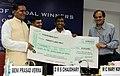 The Union Steel Minister, Shri Beni Prasad Verma presenting the cheque of Rs. 20 Lakh to Shri Yogeshwar Dutt, the London Olympic Bronze Medal winner in Wrestling, at a felicitation function, in New Delhi on August 16, 2012.jpg
