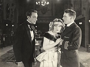 Pedro de Cordoba - Pedro de Cordoba, Marion Davies, and Forrest Stanley in a scene still from  the 1922 silent drama The Young Diana.