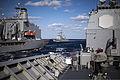 The guided missile cruiser USS Leyte Gulf (CG 55), center, prepares to come alongside the fleet replenishment oiler USNS Kanawha (T-AO 196), left, during a replenishment at sea as seen from the guided missile 131212-N-PJ969-150.jpg