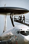 The radome of an E-3 Sentry Airborne Warning and Control System (AWACS) aircraft is serviced on the flight line DF-ST-90-02049.jpg