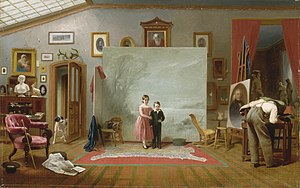 Two children pose for a photograph in an artist's studio.