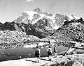 Three women viewing Mt. Shuksan, Summer 1951 (6468822381).jpg