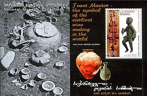 Tamada - Bronze statue from the 7th century BC discovered during archaeological excavations in the city of Vani. This statue is the statue of a Tamada, a toastmaster. The sheet also pictures amphora that were used at this time to carry and to stock the wine. Stamp of Georgia, 2007.