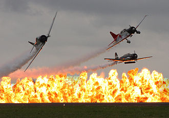 Commemorative Air Force - Tora! Tora! Tora! Gang flying a Zero, Val, and Kate, break over wall of fire created by the Tora Bomb Squad