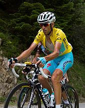 Vincenzo Nibali wearing a yellow cycling jersey.