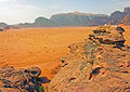 Tourists looking over Wadi Rum valley from outcrop.jpg