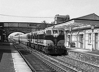 Newbridge railway station (Ireland) - Two CIÉ 141/181 class locomotives bring the 7:30 Westport - Dublin passenger train into Newbridge station in 1986