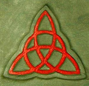 Triquetra - The triquetra interwoven with a circle, depicted on the cover of the Book of Shadows in the American television series Charmed.