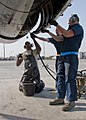 U.S. Air Force Senior Airman William Smith, an E-3 Sentry aircraft engines technician with the Sentry Aircraft Maintenance Unit, 380th Expeditionary Aircraft Maintenance Squadron, services the aircraft's 140312-F-XR500-102.jpg