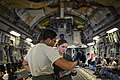 U.S. Air Force Staff Sgt. Robert Clark, left, and Senior Airman Sydney Lyda, both C-17 Globemaster III aircraft loadmasters with the 8th Airlift Squadron, discuss proper weight management on the aircraft prior 130425-F-IO684-107.jpg