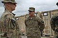U.S. Army Command Sgt. Maj. Christopher Menton, left, with the 4th Brigade Combat Team, 1st Cavalry Division, speaks with Sgt. 1st Class Taran Dailey, assigned to the 249th Engineer Battalion, at Bagram 130510-A-XM609-009.jpg