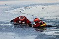 U.S. Coast Guard Seaman Michael Holmes, left, gives instructions to Seaman Jekeydon Pratcher as he is pulled out of the water during a training scenario in Milwaukee, Wis., Jan. 15, 2013 130115-G-XQ144-003.jpg