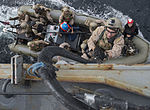 U.S. Marines assigned to the 13th Marine Expeditionary Unit embarked aboard the amphibious assault ship USS Boxer (LHD 4) climb aboard the guided missile destroyer USS Mason (DDG 87) from a rigid-hull inflatable 140112-N-PW661-066.jpg