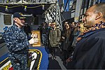 U.S. Navy Cmdr. Jonathan Schmitz, left, the commanding officer of the guided missile destroyer USS Fitzgerald (DDG 62), welcomes members of the Council on Foreign Relations for a ship visit in Yokosuka, Japan 140310-N-ZS026-020.jpg