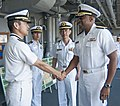 U.S. Navy Rear Adm. Frank Ponds, right, the commander of Navy Region Hawaii and Naval Surface Group Middle Pacific, speaks with Japanese Maritime Self-Defense Force (JMSDF) Capt. Yasuhiro Sato, left, the chief 130516-N-WX059-022.jpg