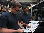 U.S. Navy Seaman Apprentice Donald E. Brown, left, goes over a compartment checklist with assistance from Seaman Charles Hancock in the aft boatswains' locker aboard the aircraft carrier USS Nimitz (CVN 68) 130731-N-TX484-031.jpg