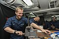 U.S. Navy Seaman Nicholas Sico, left, makes a sheave in the sail loft aboard the aircraft carrier USS Harry S. Truman (CVN 75) in the Gulf of Aden Aug. 25, 2013 130825-N-CE241-039.jpg
