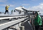 U.S. Sailors prepare an F-A-18C Hornet aircraft assigned to Strike Fighter Squadron (VFA) 37 for launch on the flight deck of the aircraft carrier USS Harry S. Truman (CVN 75) in the Atlantic Ocean July 31 130731-N-GR168-002.jpg