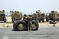 U.S. Soldiers with Echo Company, 3-10 General Support Aviation Battalion sit with fuel containers during sling load training at Bagram Airfield, Afghanistan, July 30, 2013 130730-A-YW808-035.jpg
