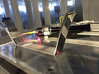 Ultrasonic consolidation - Embedding a temperature sensitive fiber optic cable.