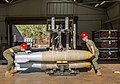 USMC airmen load bombs onto a bomb skid at RAAF Base Tindal in August 2016.jpg