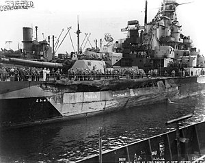 USS Indiana (BB-58) - Indiana in dock in Pearl Harbor showing the temporary repairs after the collision with Washington